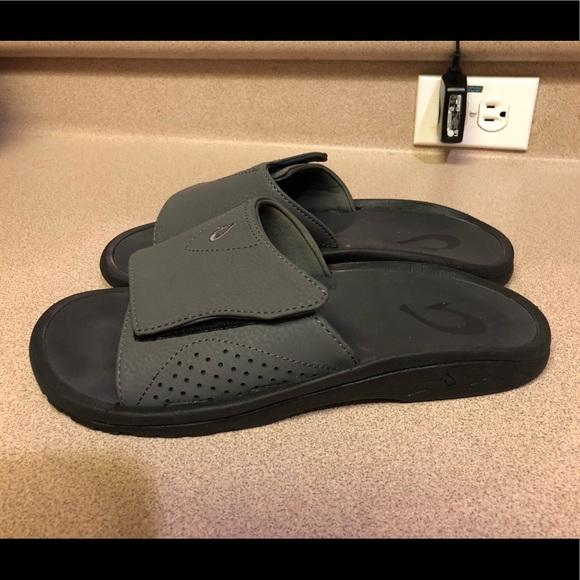 21646476695c PreOwned Olukai Nalu Slide Men s 9 Black Sandals. M 5b96d500aa57196657863a59